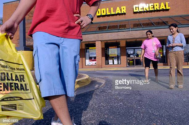 Mauro Delgado left exits a Dollar General store in Sandy Springs GA with his mother Epifania Salazar center and sister Maria Delgado on Monday March...