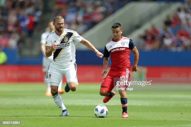 Mauro Diaz of FC Dallas controls the ball against Perry Kitchen of LA Galaxy during the Major Soccer League match between Dallas FC and LA Galaxy at...