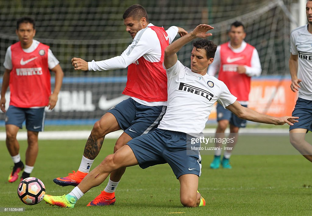 Mauro Emanuel Icardi competes with Marco Andreolli during the FC Internazionale training session at the club's training ground 'La Pinetina' on September 30, 2016 in Como, Italy.
