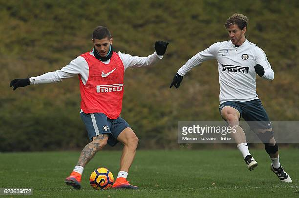 Mauro Emanuel Icardi is challenged by Christian Ansaldi during the FC Internazionale training session at the club's training ground La Pinetina on...