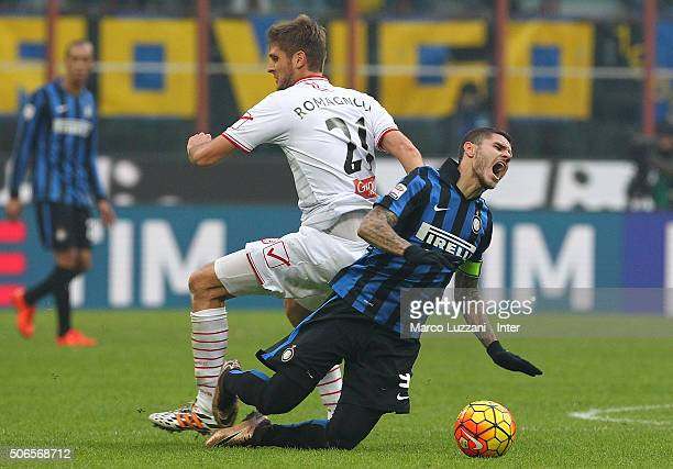 Mauro Emanuel Icardi of Carpi FC clashes with Simone Romagnoli of FC Internazionale Milano during the Serie A match between FC Internazionale Milano...