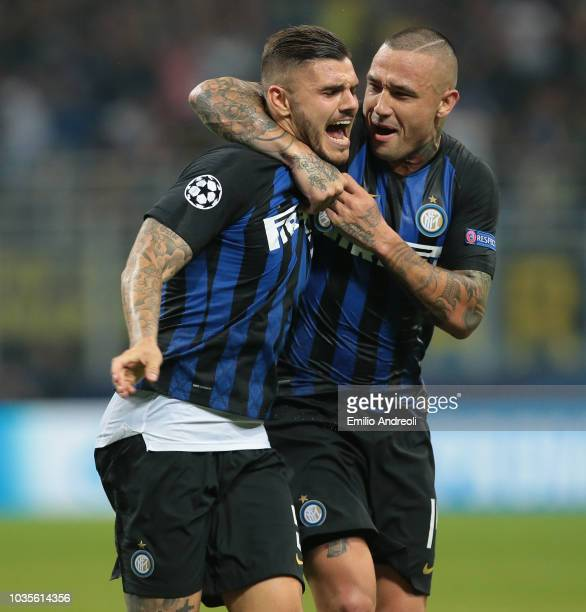 Mauro Emanuel Icardi of FC Internazionale celebrates his goal with his teammate Radja Nainggolan during the Group B match of the UEFA Champions...