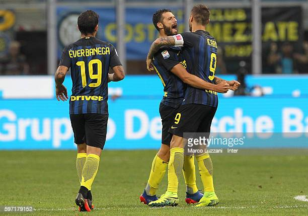 Mauro Emanuel Icardi of FC Internazionale celebrates his goal with his teammate Antonio Candreva during the Serie A match between FC Internazionale...