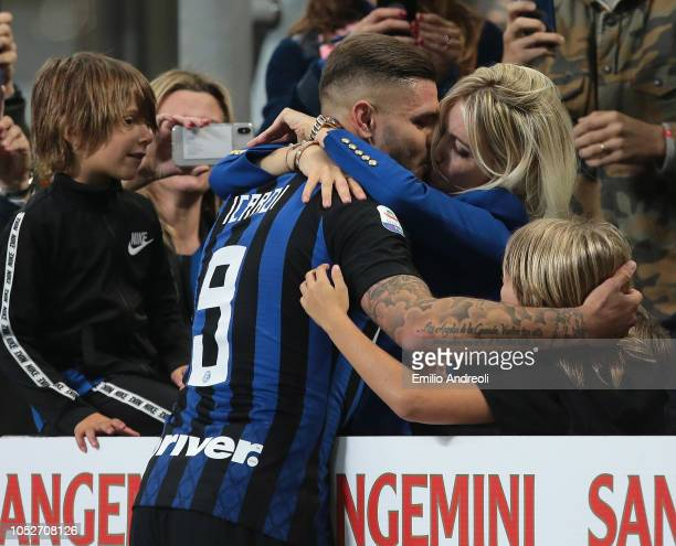 Mauro Emanuel Icardi of FC Internazionale embraces his wife Wanda Nara at the end of the Serie A match between FC Internazionale and AC Milan at...
