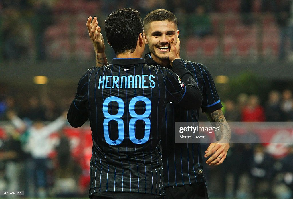 Mauro Emanuel Icardi (R) of FC Internazionale Milano celebrates his goal with his team-mate Anderson Hernanes (L) during the Serie A match between FC Internazionale Milano and AS Roma at Stadio Giuseppe Meazza on April 25, 2015 in Milan, Italy.