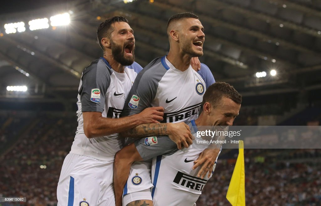Mauro Emanuel Icardi of FC Internazionale Milano (C) celebrates his second goal with his team-mates Antonio Candreva (L) and Ivan Perisic (R) during the Serie A match between AS Roma and FC Internazionale on August 26, 2017 in Rome, Italy.