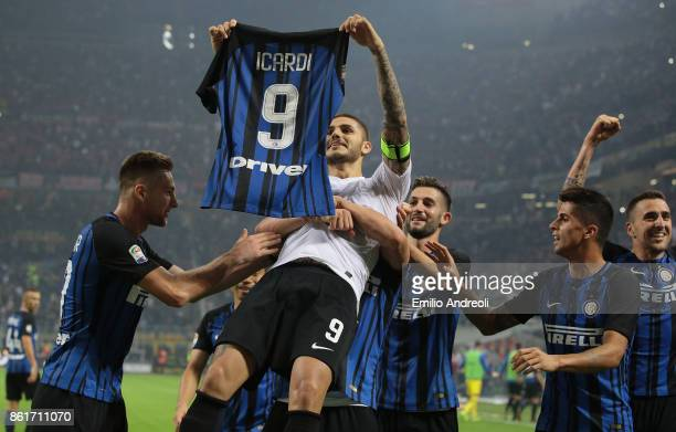 Mauro Emanuel Icardi of FC Internazionale Milano celebrates his third goal with his teammates during the Serie A match between FC Internazionale and...