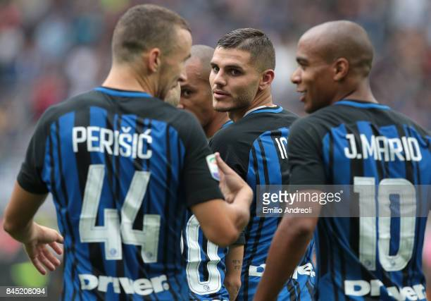 Mauro Emanuel Icardi of FC Internazionale Milano celebrates with his teammates Ivan Perisic and Joao Mario after scoring the opening goal during the...