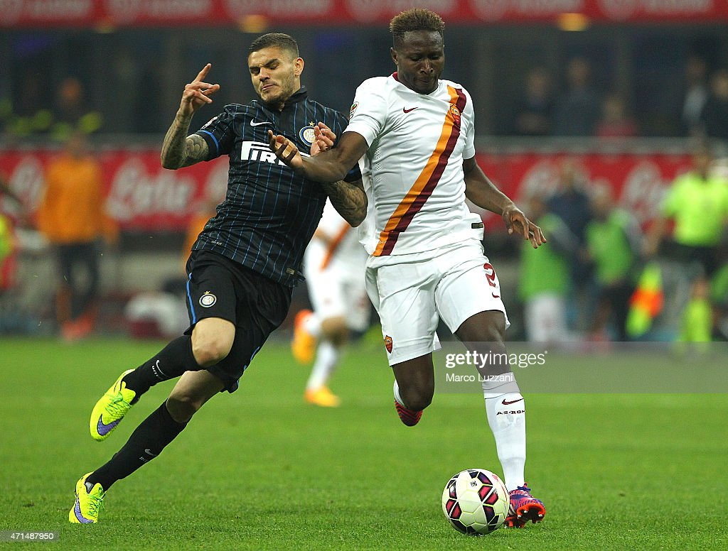 Mauro Emanuel Icardi (L) of FC Internazionale Milano competes for the ball with Mapou Yanga-Mbiwa (R) of AS Roma during the Serie A match between FC Internazionale Milano and AS Roma at Stadio Giuseppe Meazza on April 25, 2015 in Milan, Italy.