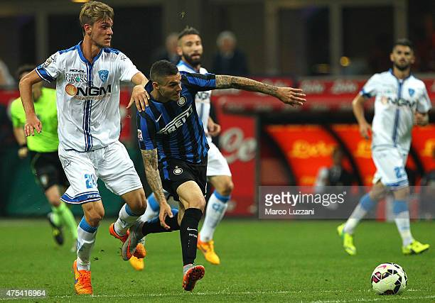 Mauro Emanuel Icardi of FC Internazionale Milano competes for the ball with Daniele Rugani of Empoli FC during the Serie A match between FC...