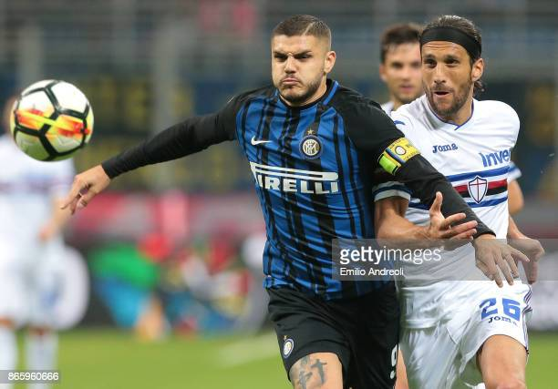Mauro Emanuel Icardi of FC Internazionale Milano competes for the ball with Matias Silvestre of UC Sampdoria during the Serie A match between FC...