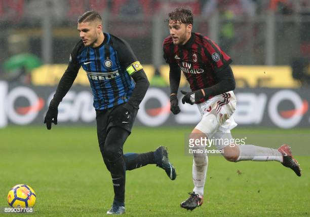 Mauro Emanuel Icardi of FC Internazionale Milano is challenged by Manuel Locatelli of AC Milan during the TIM Cup match between AC Milan and FC...