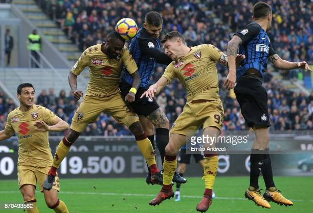 Mauro Emanuel Icardi of FC Internazionale Milano jumps for the ball with Nicolas N'Koulou and Andrea Belotti of Torino FC during the Serie A match...