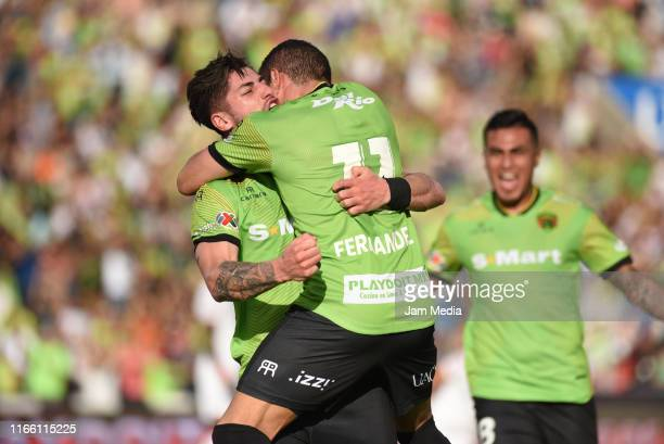 Mauro Fernandez of Juarez celebrates with teammates after scoring the first goal of his team during the 3rd round match between FC Juarez and Toluca...