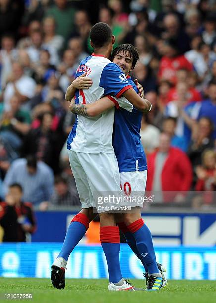 Mauro Formica of Blackburn Rovers celebrates scoring the opening goal with teammate Steven Nzonzi during the Barclays Premier League match between...