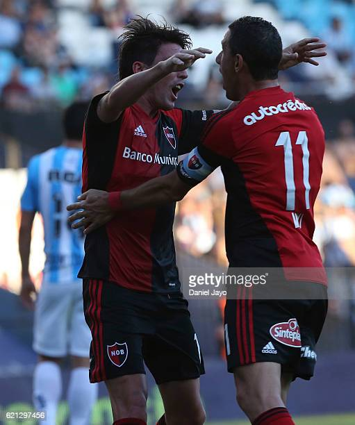 Mauro Formica of Newell's Old Boys celebrates with teammate Maximiliano Rodriguez of Newell's Old Boys after scoring during a match between Racing...