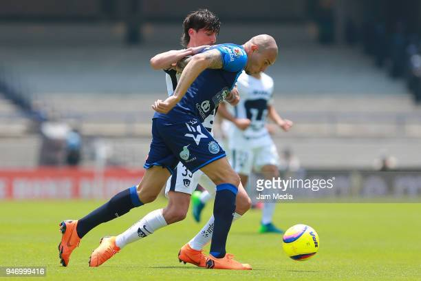 Mauro Formica of Pumas and Jorge Enriquez of Puebla fight for the ball during the 15th round match between Pumas UNAM and Puebla as part of the...