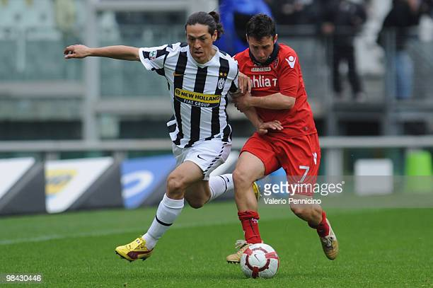 Mauro German Camoranesi of Juventus FC is challenged by Andrea Cossu of Cagliari Calcio during the Serie A match between Juventus FC and Cagliari...