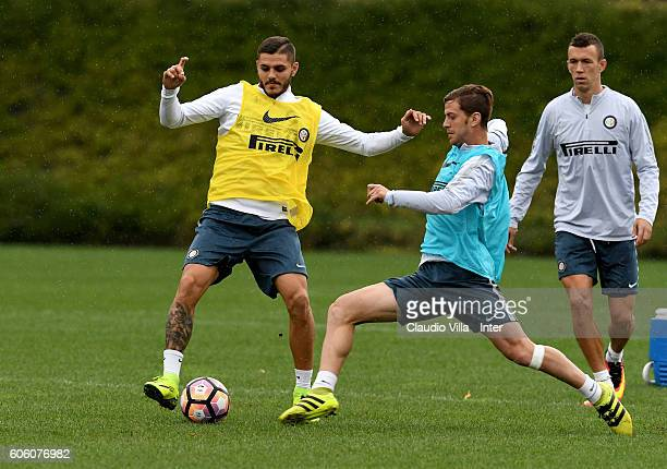 Mauro Icardi and Cristian Ansaldi compete for the ball during the FC Internazionale training session at the club's training ground at Appiano Gentile...