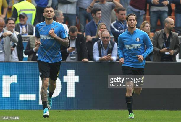 Mauro Icardi and Cristian Ansaldi of FC Internazionale warm up ahead of the Serie A match between FC Internazionale and AC Milan at Stadio Giuseppe...