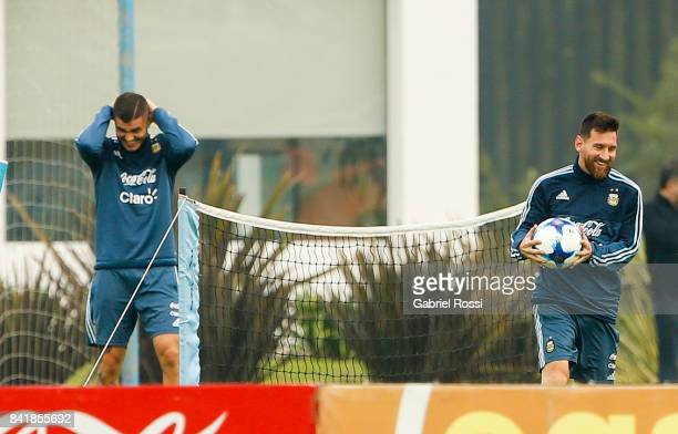 Mauro Icardi and Lionel Messi of Argentina smile during a training session at 'Julio Humberto Grondona' training camp on September 02 2017 in Ezeiza...
