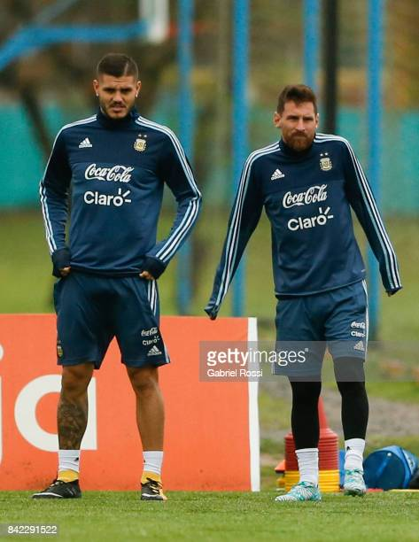 Mauro Icardi and Lionel Messi of Argentina warm up during a training session at 'Julio Humberto Grondona' training camp on September 03 2017 in...