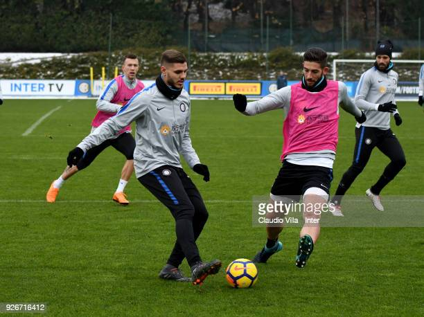 Mauro Icardi and Roberto Gagliardini of FC Internazionale compete for the ball during the FC Internazionale training session at the club's training...