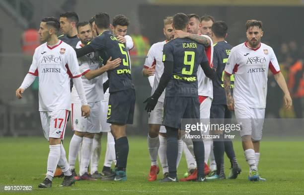 Mauro Icardi and Roberto Gagliardini of FC Internazionale embraces players of Pordenone during the TIM Cup match between FC Internazionale and...
