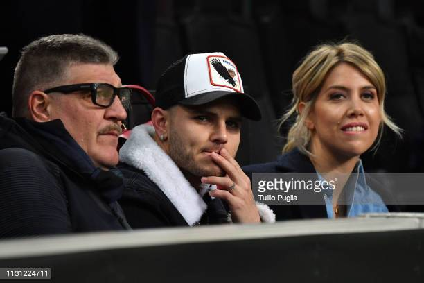 Mauro Icardi and Wanda Nara look on in VIP standing during the UEFA Europa League Round of 32 Second Leg match between FC Internazionale and SK Rapid...