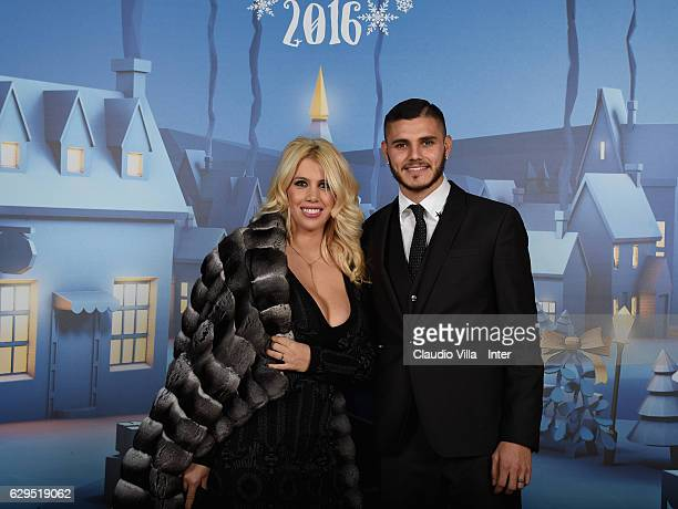 Mauro Icardi and Wanda Nara pose for a photo during FC Internazionale Christmas Dinner on December 13 2016 in Milan Italy