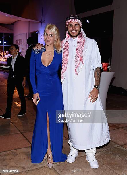 Mauro Icardi and Wanda Nara pose for a photo during the FC Internazionale party at Hotel St Regis on January 1 2016 in Doha Qatar