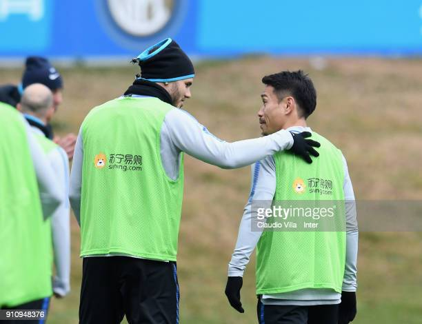 Mauro Icardi and Yuto Nagatomo of FC Internazionale chat during a FC Internazionale training session at Suning Training Center at Appiano Gentile on...