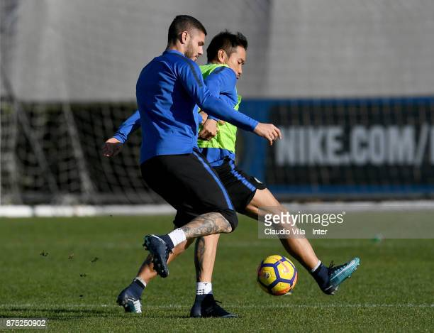 Mauro Icardi and Yuto Nagatomo of FC Internazionale compete for the ball during the FC Internazionale training session at Suning Training Center at...