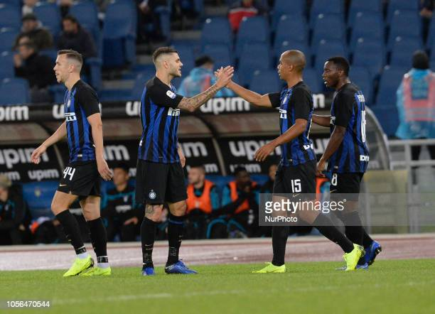 Mauro Icardi celebrates with Joao Mario after scoring goal 01 during the Italian Serie A football match between SS Lazio and Inter at the Olympic...