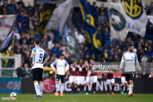 Mauro Icardi Joao Cancelo and Roberto Gagliardini of FC Internazionale look dejected after a goal of Torino FC during the Serie A football match...