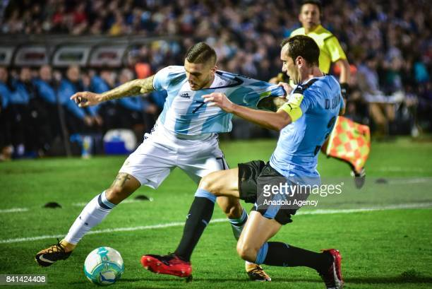 Mauro Icardi of Argentina and Diego Godin of Uruguay vie for the ball during the 2018 FIFA World Cup qualifying match between Uruguay and Argentina...