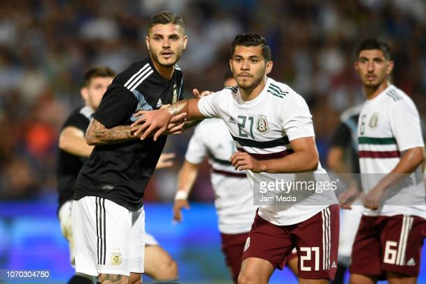 Mauro Icardi of Argentina and Henry Martin of Mexico look on during a friendly match between Argentina and Mexico at Malvinas Argentinas Stadium on...