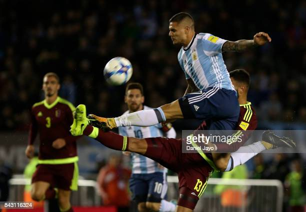Mauro Icardi of Argentina and John Chancellor of Venezuela fight for the ball during a match between Argentina and Venezuela as part of FIFA 2018...