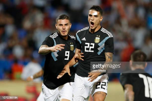 Mauro Icardi of Argentina celebrates with teammate Erik Lamela after scoring the fist goal of his team during a friendly match between Argentina and...