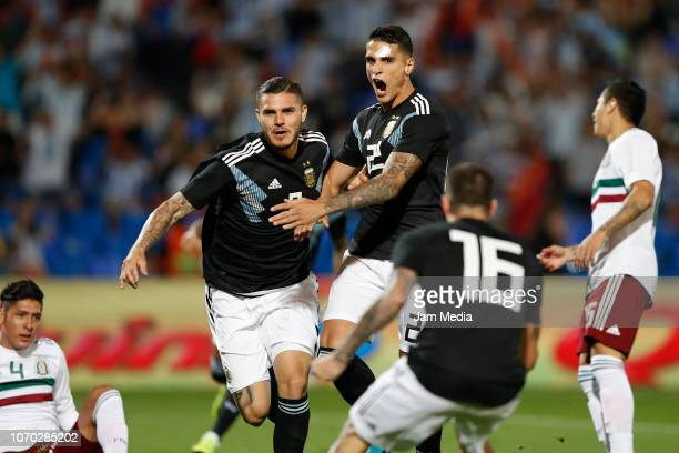 Mauro Icardi of Argentina celebrates with teammates Erik Lamela and Rodrigo de Paul after scoring the fist goal of his team during a friendly match...
