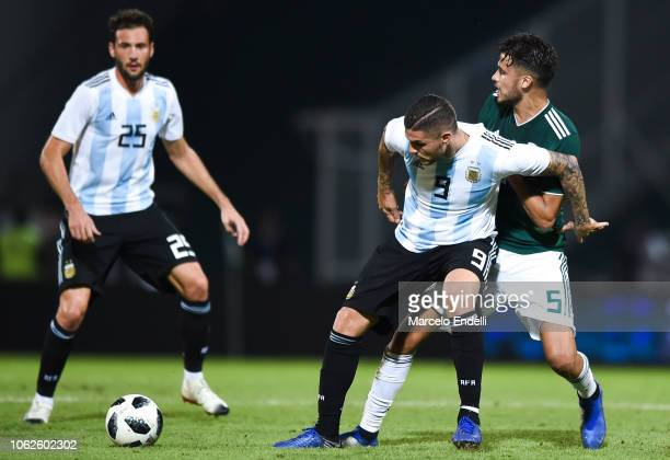 Mauro Icardi of Argentina fights for the ball with Diego Reyes of Mexico during a friendly match between Argentina and Mexico at Mario Kempes Stadium...