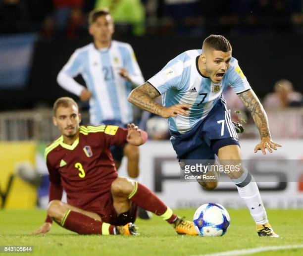 Mauro Icardi of Argentina fights for the ball with Mikel Villanueva of Venezuela during a match between Argentina and Venezuela as part of FIFA 2018...