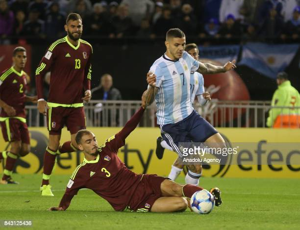 Mauro Icardi of Argentina in action against Victor Garcíoa of Venezuela during the FIFA 2018 World Cup Qualifiers football match between Argentina...