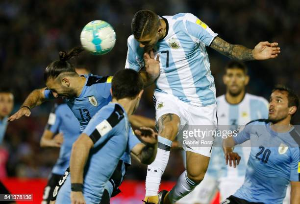 Mauro Icardi of Argentina jumps for a header with Gaston Silva of Uruguay during a match between Uruguay and Argentina as part of FIFA 2018 World Cup...