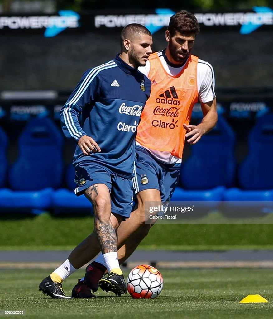 Mauro Icardi of Argentina kicks the ball followed by teammate Federico Fazio during a training session at Argentine Football Association (AFA) 'Julio Humberto Grondona' training camp on October 06, 2017 in Ezeiza, Argentina.