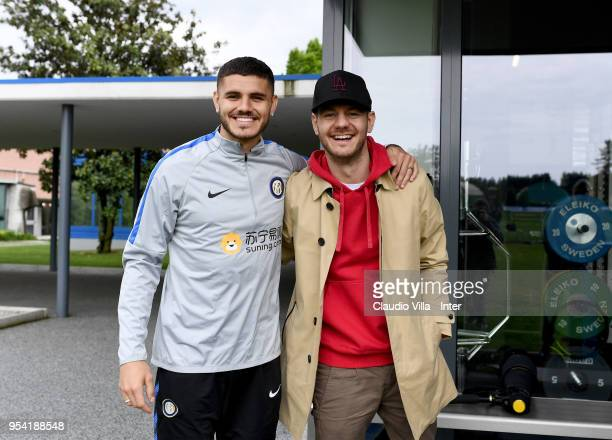 Mauro Icardi of FC Internazionale and Alessandro Cattelan pose for a photo during the FC Internazionale training session at the club's training...