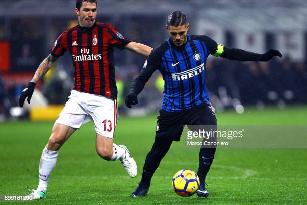 Mauro Icardi of FC Internazionale and Alessio Romagnoli of Ac Milan in action during the Tim Cup football match between Ac Milan and Fc...