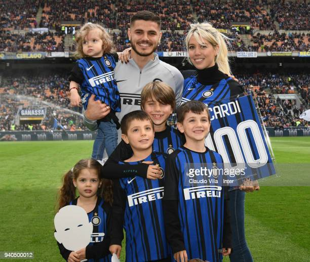 Mauro Icardi of FC Internazionale and family receives the award for 100 goals whit FC Internazionale before the serie A match between FC...
