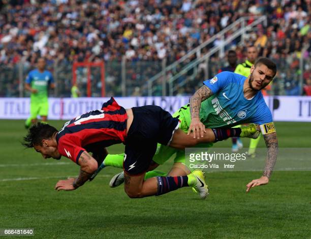 Mauro Icardi of FC Internazionale and Federico Ceccherini of FC Crotone compete for the ball during the Serie A match between FC Crotone and FC...