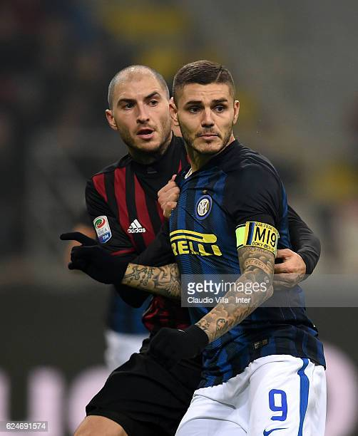 Mauro Icardi of FC Internazionale and Gabriel Paletta compete during the Serie A match between AC Milan and FC Internazionale at Stadio Giuseppe...